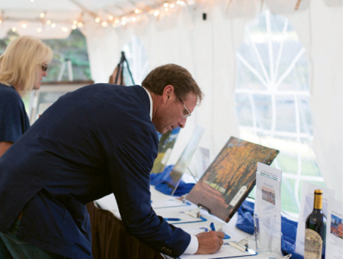Nelson Rogers placed a bid in the silent  auction, which featured nearly 100 items.