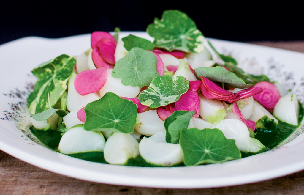 Vanilla-glazed Hakurei turnips garnished with nasturtium and rose petals