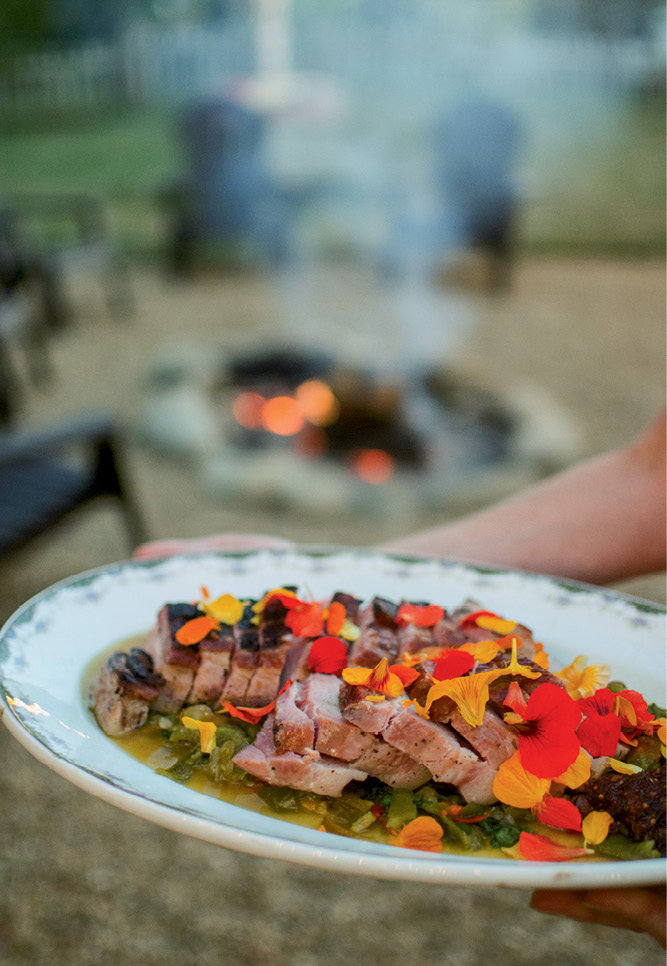 The pork belly was seared over an open fire in the backyard and served with a spicy-sweet agrodolce.