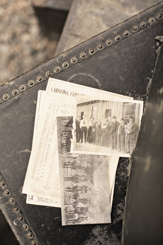 Old photos of the early railroad days, a train schedule printed to look old, a vintage suitcase, and antique mining tools  were among the props gathered to help retell the story of Spruce Pine's past.