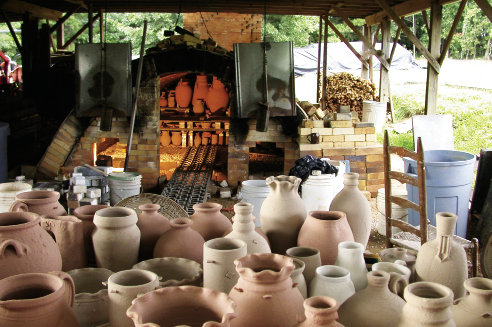 Feel the Heat Ellington fires 400 to 600 pots in his wood-burning groundhog kiln three times a year. Each firing takes up to 18 hours.