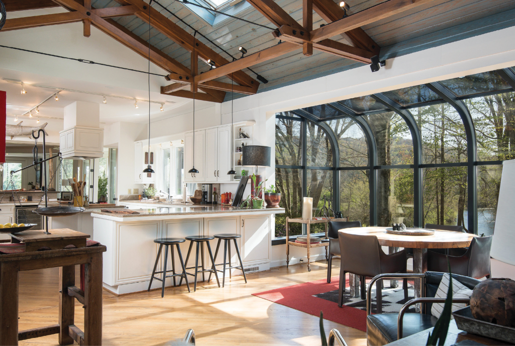 Platt reimagined the kitchen with fresh white paint and new hardware. He added new lighting and painted the solarium framing dark.