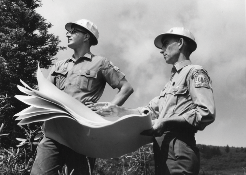 Forest Service surveyors scope out a road project in the mid 1960s.