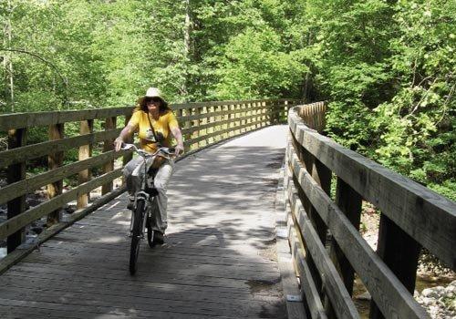 bikers  traverse multiple trestle bridges