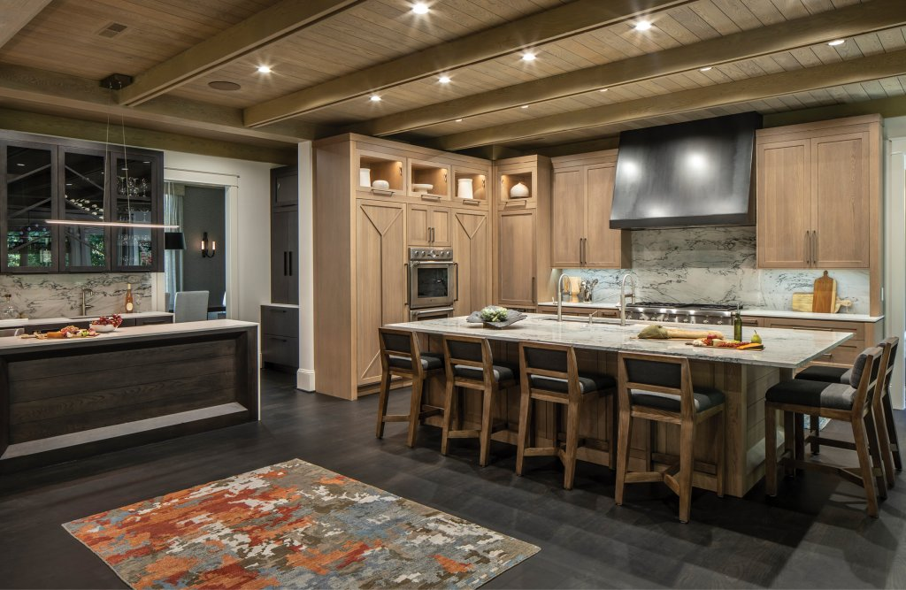 Pattern and texture play a role in the kitchen's quartzite island countertop and backsplash as well as the white oak cabinetry. Roberts says subtle pattern repetition can be used to unify the look of an entire home.