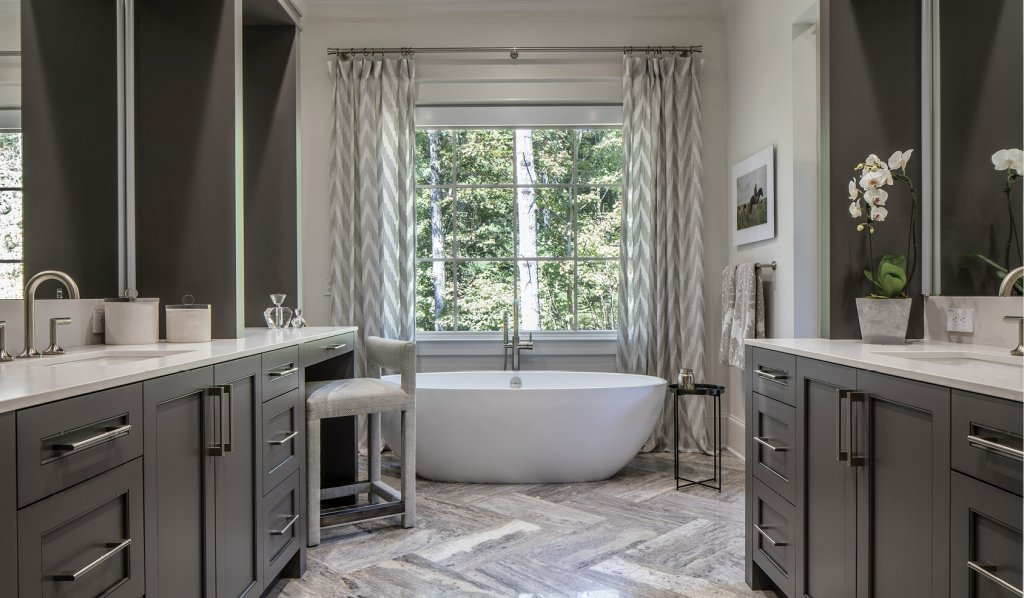 The master bathroom received an overhaul, including new cabinetry, countertops, bathtub, and window treatments.