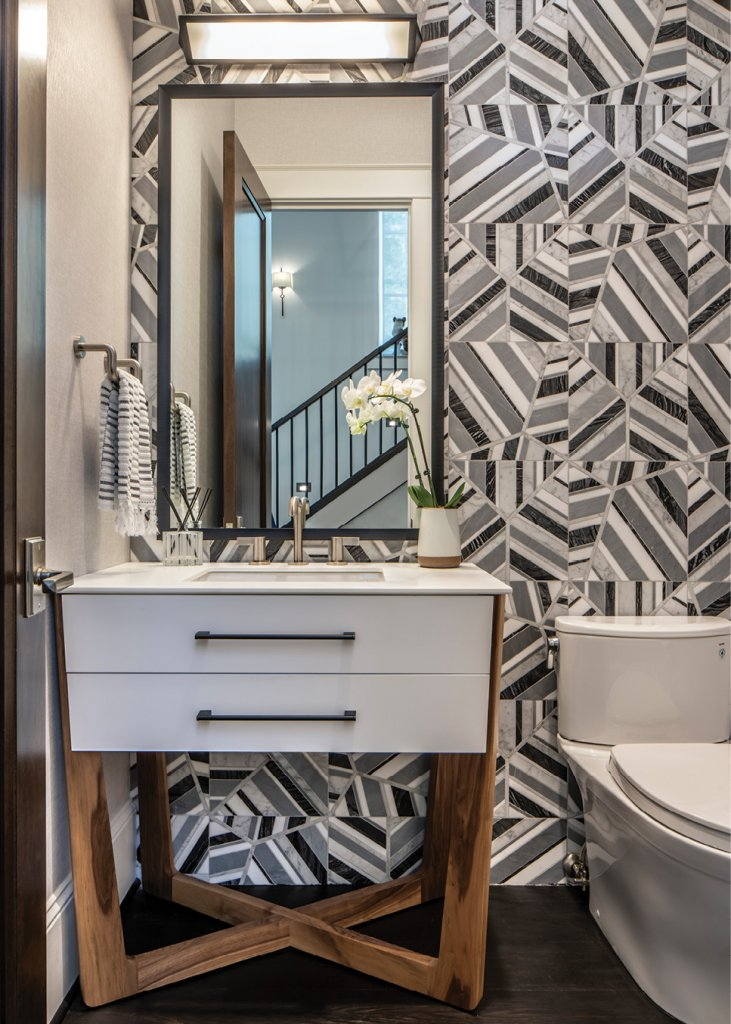 Geometric tile mosaic in the powder room.
