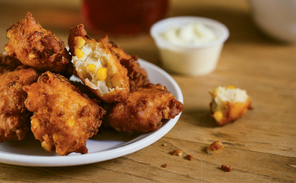 Full Plate - A jalapeño-lime aioli provides zest to the corn fritters appetizer.