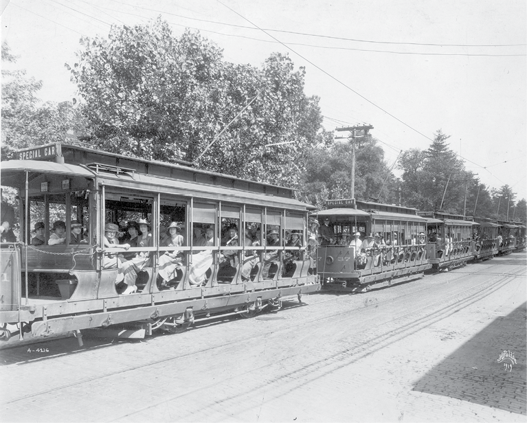 A string of streetcars takes teachers to the Asheville Normal School in 1919.