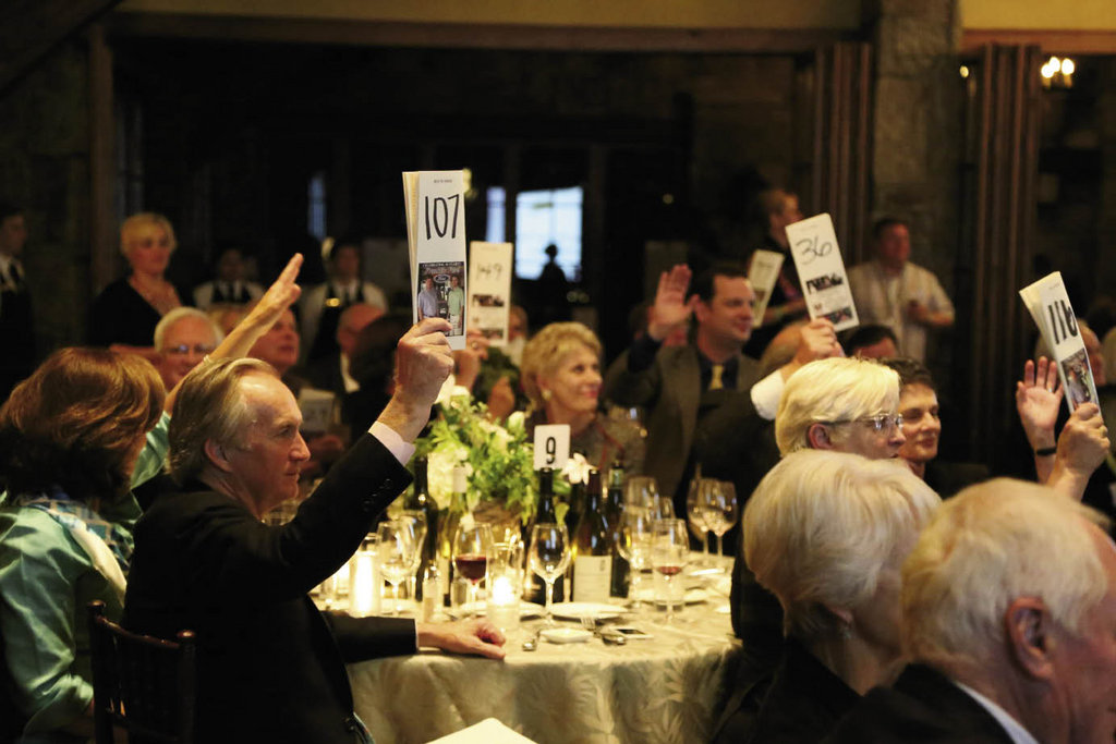 Attendees bid on rare and collectible wines, private dinners, and more at Saturday's auction.