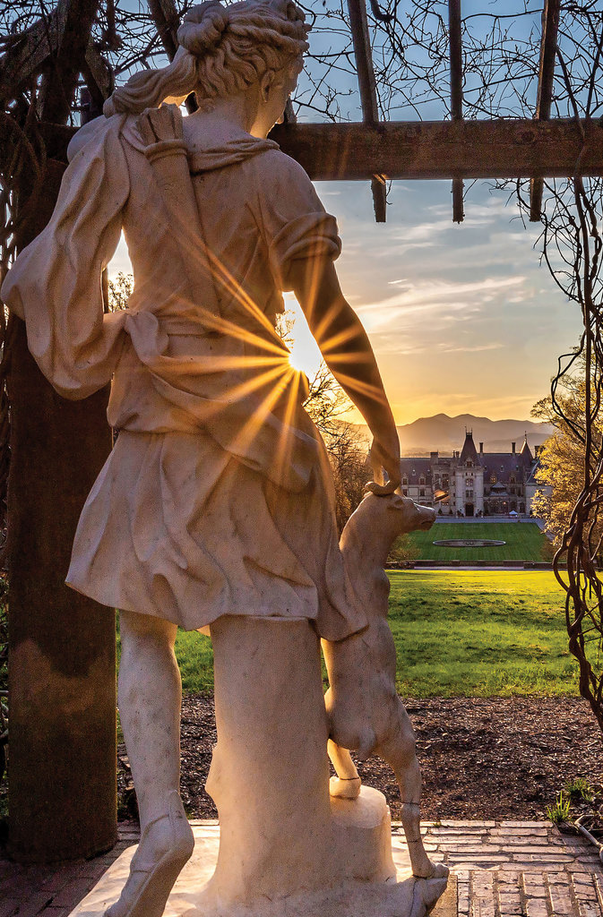 AMATEUR CATEGORY - Biltmore Sunset - Chesley Lanford - Overlooking the Biltmore, the marble Diana statue is punctuated with just a starburst of light from the setting sun.