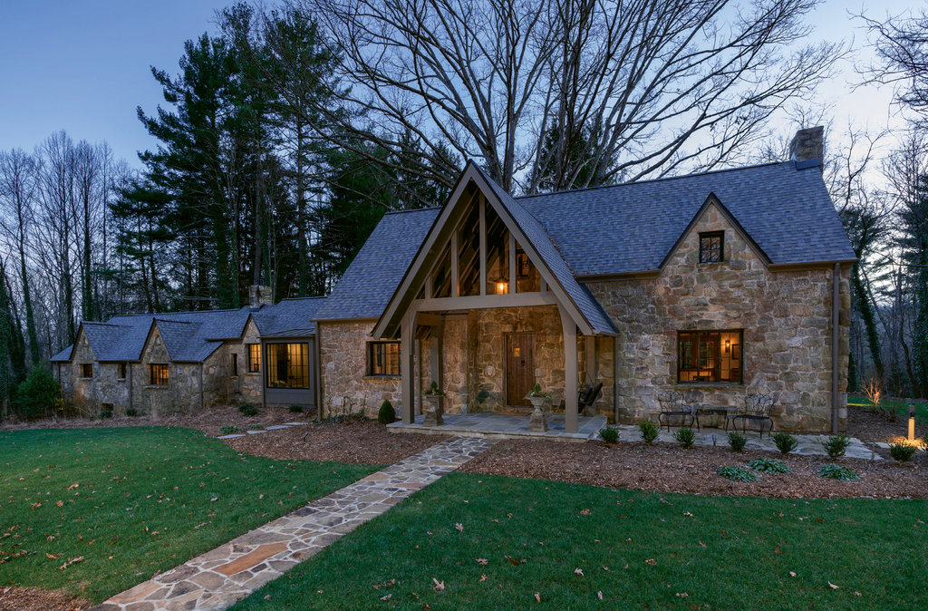 The 1920s fieldstone house, which butts up to the North Carolina Arboretum property and miles of wooded trails, received a face-lift with the addition of a covered entry that blends with the era of the home.