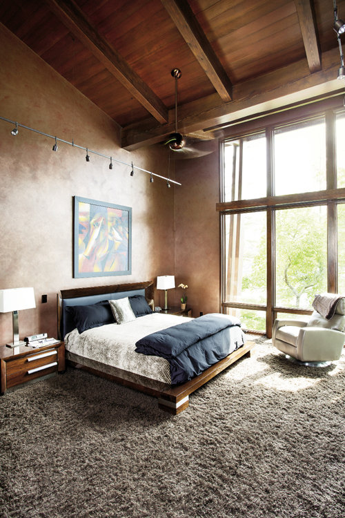 Dark walls in the master bedroom put the focus on the views