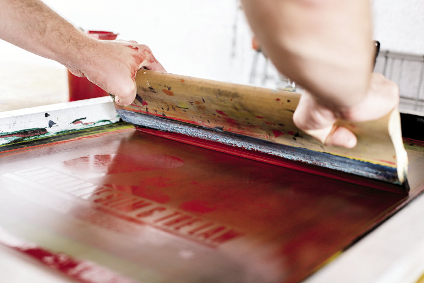 Findley screen prints each poster, T-shirt, or any other surface by hand. Photograph by Christopher Shane
