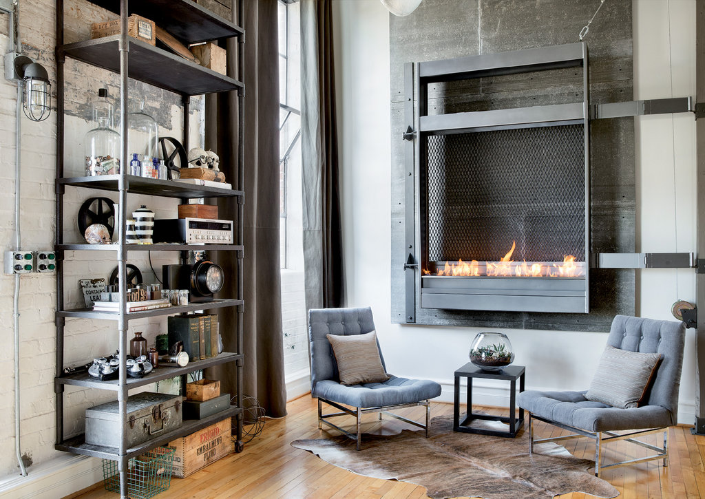 A metal shelf in the great room holds an array of vintage medical tools sourced from antique shops and estate auctions, while the fireplace was designed by Hodge and built by Dennis Moser of Alloy Welding Company.