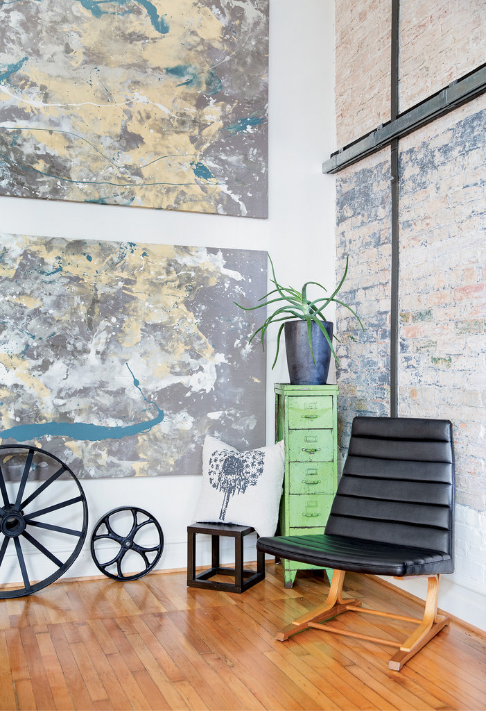 Eclectic antiques, including a 1960s Edward Wormley-designed chair, and contemporary design meld in Melissa Davidian and Shane Hodge's loft.