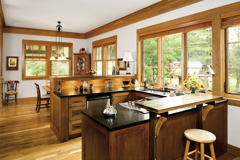 Banks of windows bathe the kitchen and dining room in sunlight.