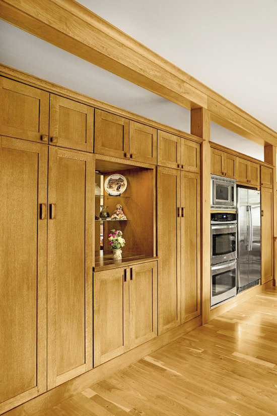 A wall of handsome custom cabinets frames the space and provides ample storage.