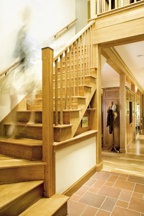 The staircase features a removable railing that allows furniture to be easily  shifted from floor to floor.