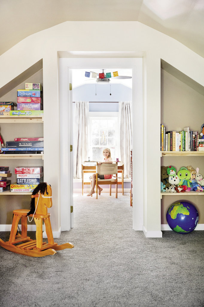 The top half-floor holds ample play space for the girls as well as Mattie Clark's room. Recessed shelving provides storage for games, books, and more.