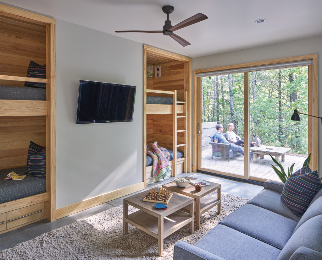 Family Rooms - The downstairs, with access to a bricked patio, houses a comfy bunk room plus two other bedrooms, all perfectly adaptable as the couple's two young children grow into teenagers and eventually adults, perhaps with children of their own.