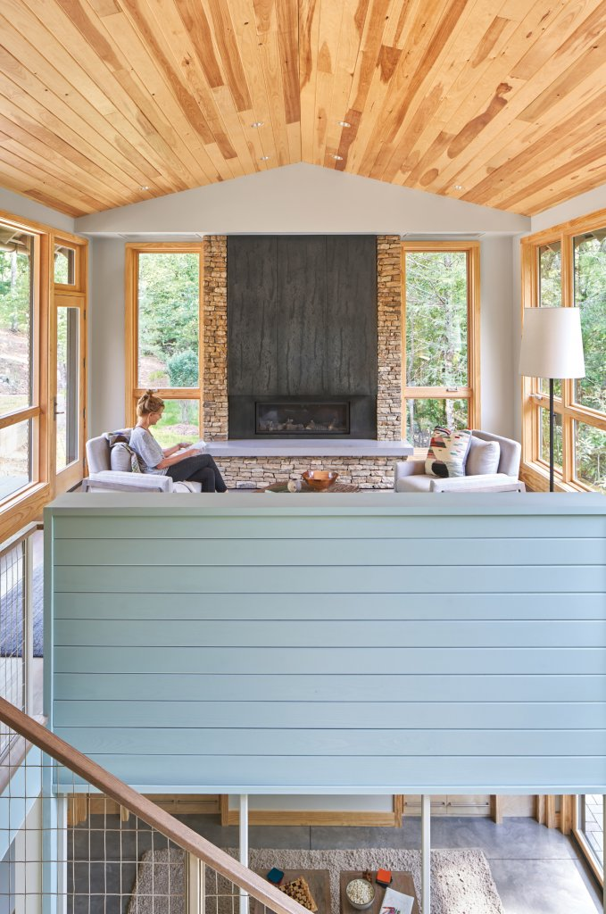Floor-to-ceiling windows and Eastern white pine wood throughout brighten the home.