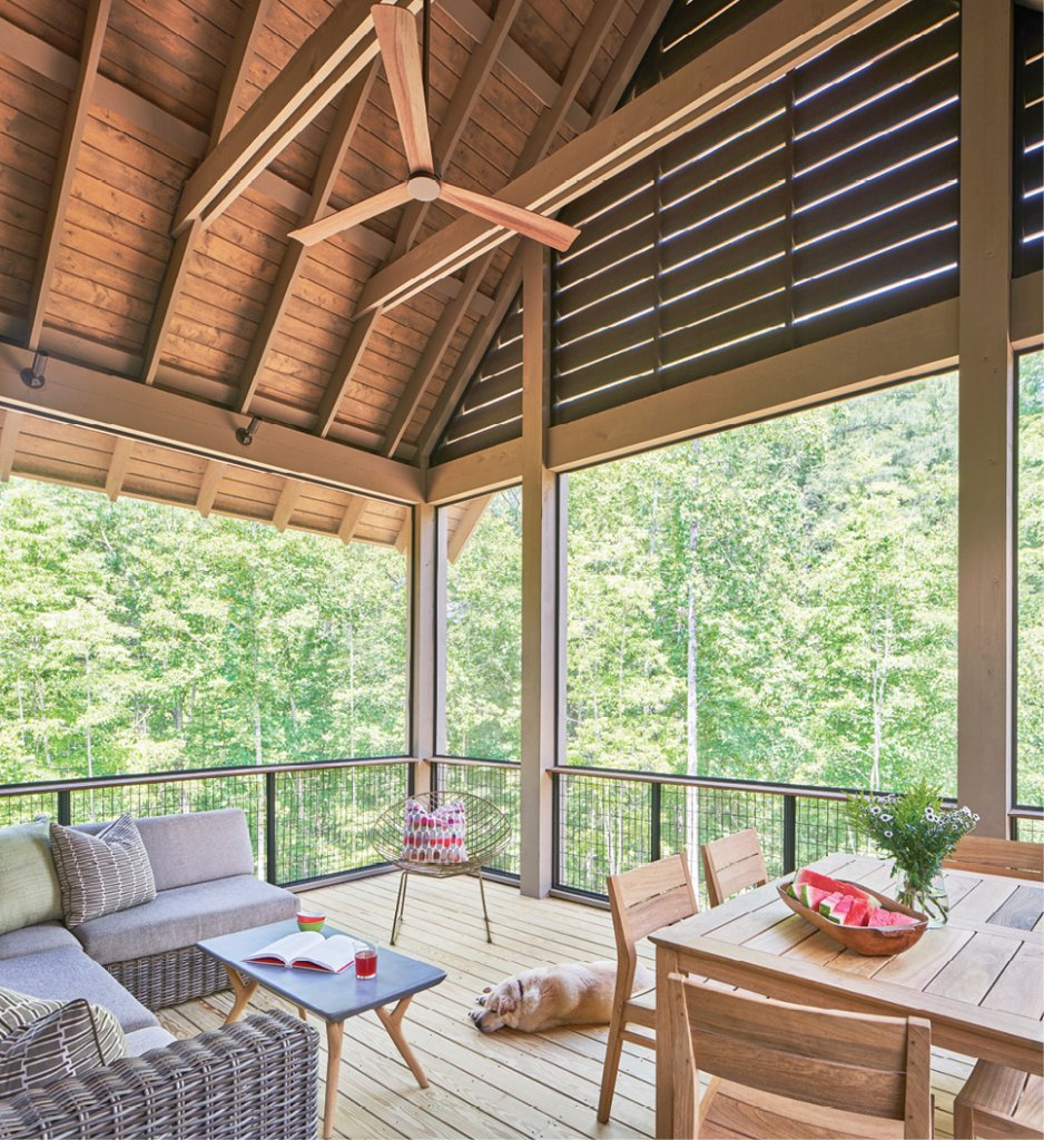 At Peace - The screened porch sits perched amid the trees and is a dreamy spot to relax with a book, enjoy a meal, or play a board game. The vaulted ceiling makes the porch feel spacious, while the corn crib-inspired slats on the gable lend an interesting lighting aspect.