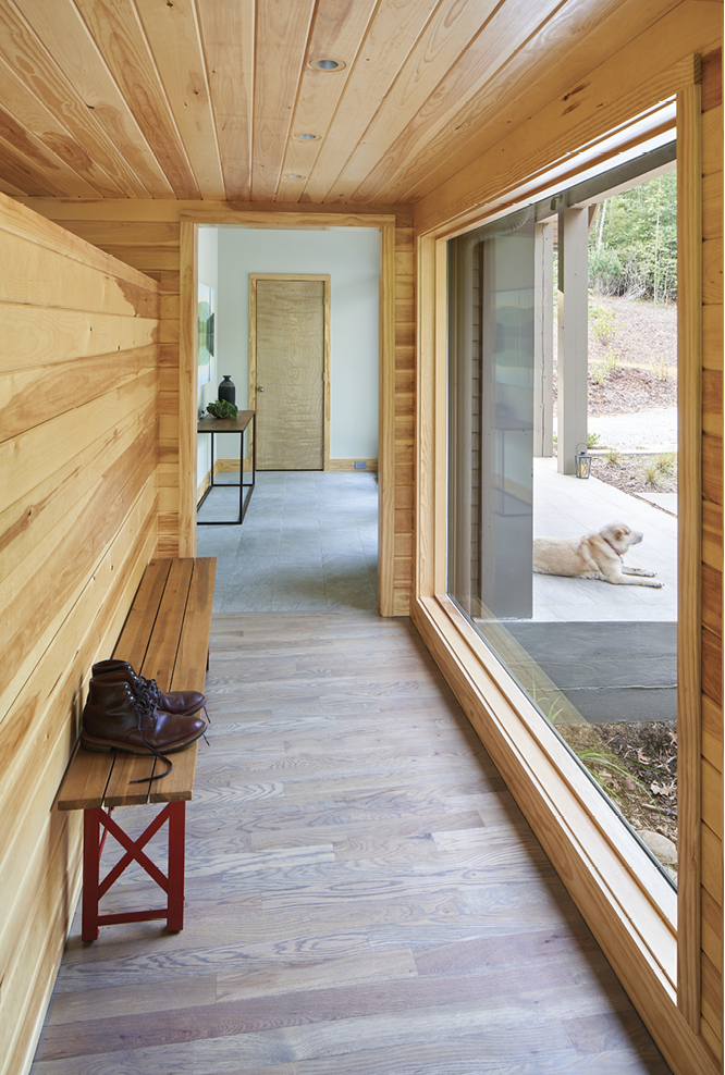 Privacy Please - The dogtrot has a glass wall on one side and a concealed butler's pantry.