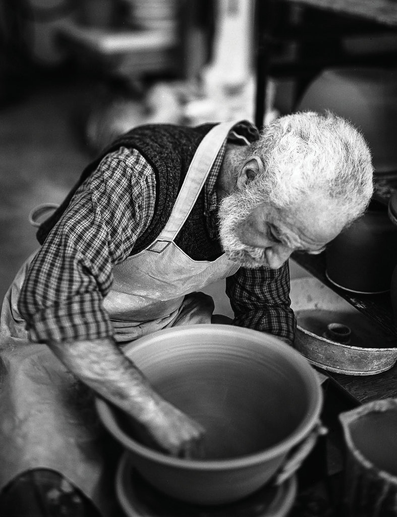 PROFESSIONAL CATEGORY - The Potter's Wheel - Chris Ellenbogen - Chris took this portrait of his father, Jon Ellenbogen of Barking Spider Pottery in Penland, using a 4x5 film