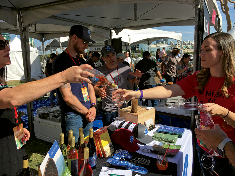 In Good Taste - The nonprofit partners with numerous wineries and vintners who support the cause. Above, volunteers share sips of Wine to Water wines and the organization's message at a festival in San Diego.