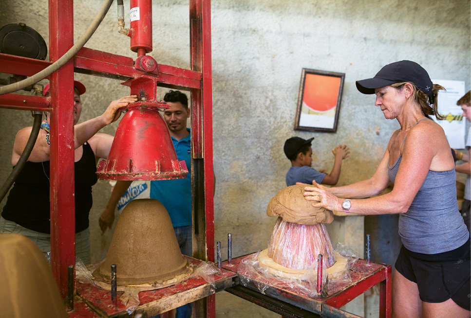 Volunteers help make ceramic filters in Dominican Republic.