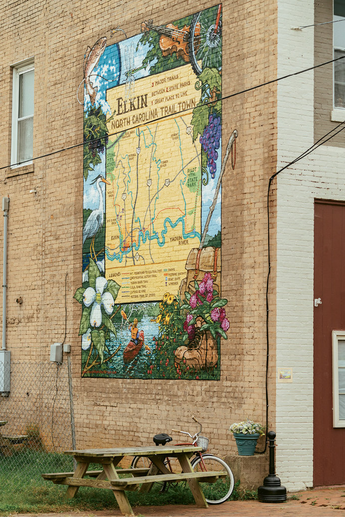Thanks to the efforts of Bill Blackley and the Elkin Valley Trails Association, a mural proudly identifying Elkin as a trail town