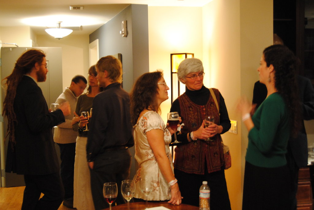 Guests begin to arrive for the Cheers For Charity fund-raiser at The Asheville Club at 151.