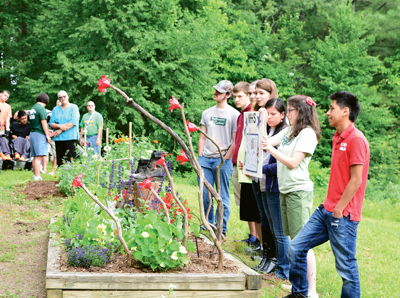 Team Effort With the BOOST job training program for Henderson County sophomores, the students work together to design and plant a garden plot and must follow a budget.
