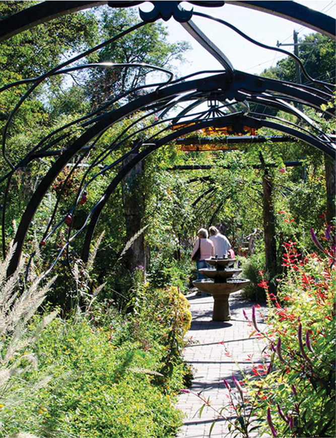 The Lake Lure Flowering Bridge overflows with lush gardens along a pedestrian pathway.
