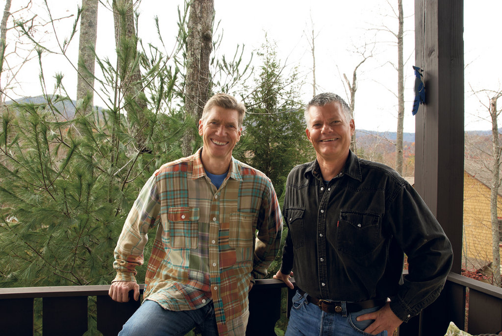 Chas Fitzgerald (left) and Jack Hammack on the balcony of their Black Mountain home.