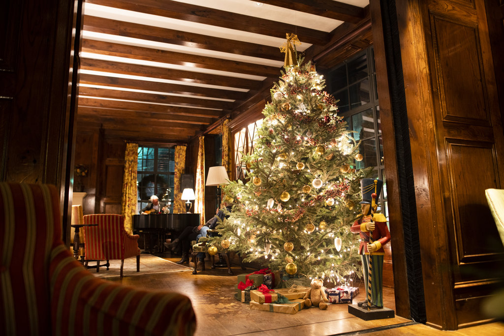 In ' Hummingbird Lounge (left) and throughout the inn, the glow of decorated trees and crackling fireplaces sets a spirited mood