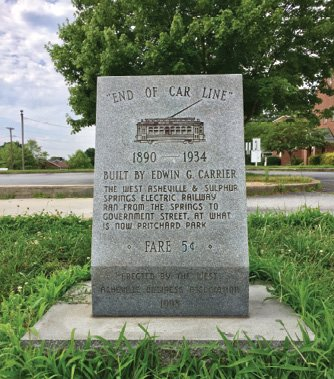 """A small monument placed on Haywood Road by the West Asheville Business Association in 1998 marks the """"end of car line"""" where the journey ended."""