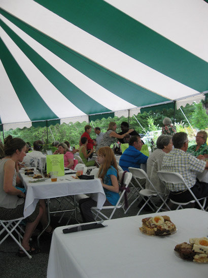Patrons enjoying their dinners under the tent