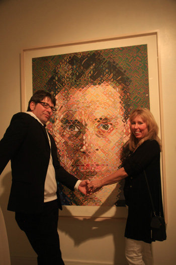 Steve Busey and Sharon Trammel in front of a Chuck Close painting