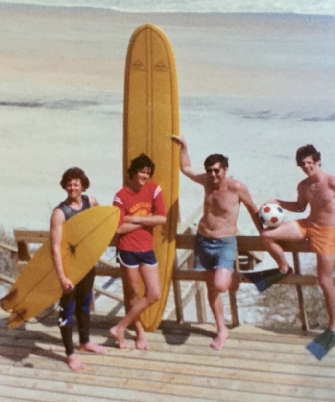 Pressly (left), his father (with longboard), and two friends at the family's Carolina beach house in the late 1970s