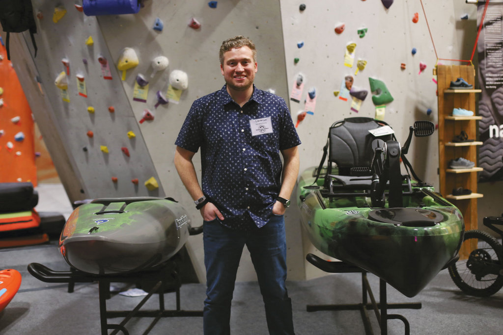 Tyler Brown with Big Adventures in Fletcher showcased watercraft at the VIP event.