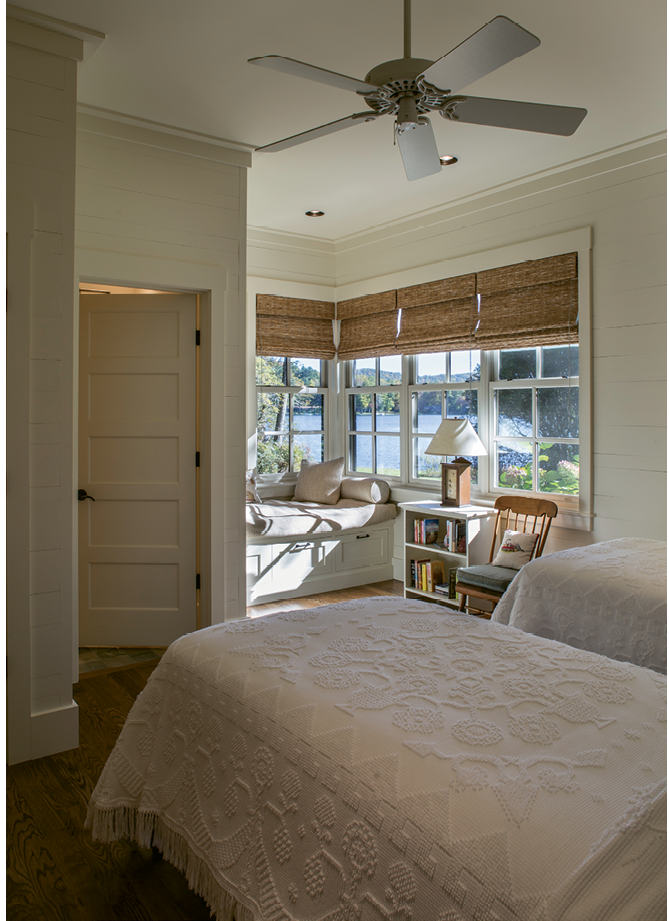 In one of the guest wing bedrooms, a window seat is a dreamy nook for kicking back with a book.