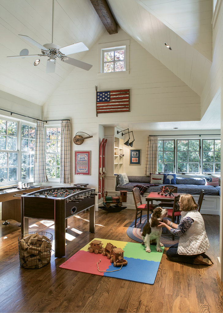 Play Time - The guest wing includes a spacious playroom fit to engage kids of all ages. Interior designer Donna Greene helped source some of the antiques here and throughout the house, many from Scott's Antiques in Atlanta.