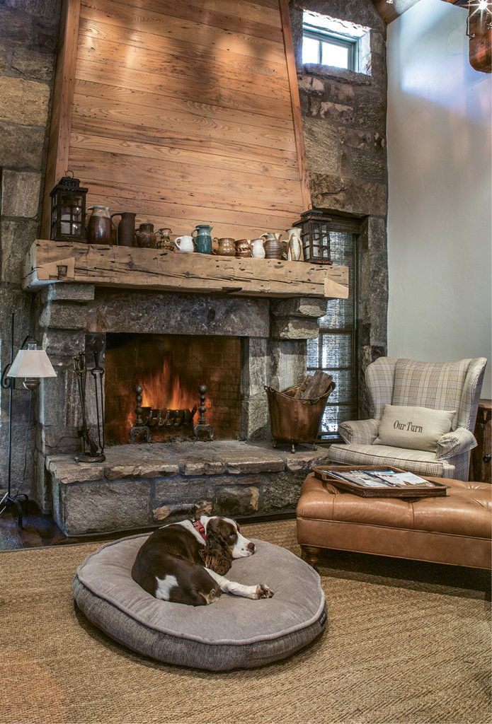 Kick Back - Whether sipping coffee or pausing while dinner cooks, the stone fireplace and sitting area at the opposite end of the kitchen is the most used space in the house.