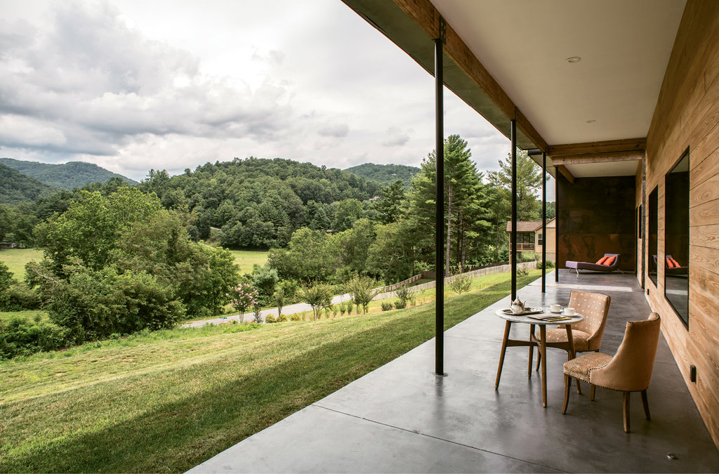 A 900-square-foot covered porch overlooking a valley and mountains