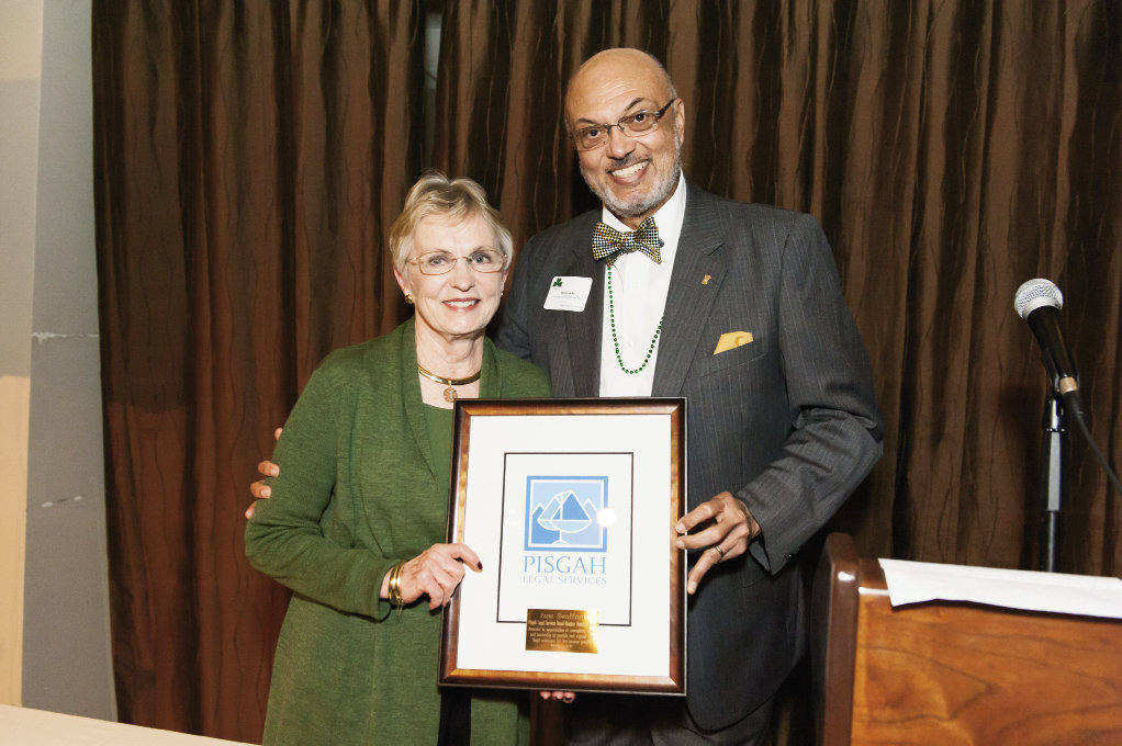 Don Locke honored Jane Swafford for her board service to Pisgah Legal Services.