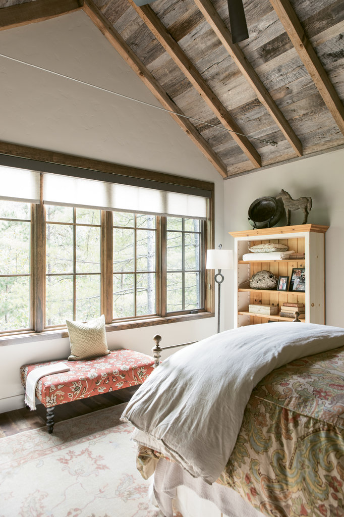 The upstairs loft bedroom is one of four, all decorated to suit the homeowners' rustic-meets-modern farmhouse-style aesthetic.