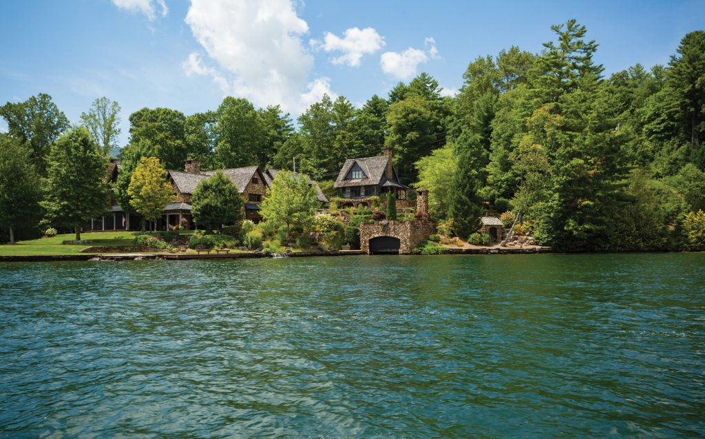 Just like each boat on the lake carries a story, so do many of the homes that surround it. Below, this lakefront property and log cabin (the guest quarters) are surprisingly new but built to reflect an air of historic character.