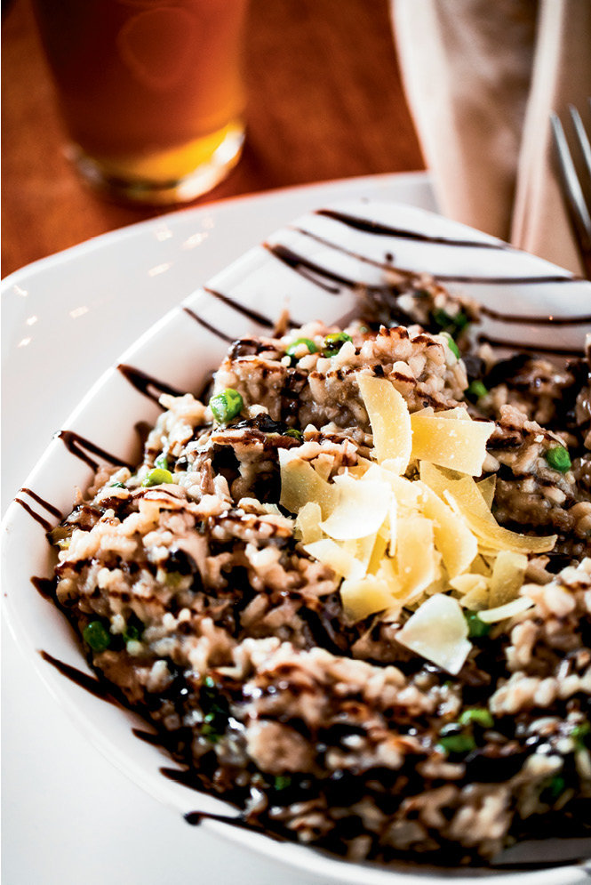 Spring Bounty: The Bistro updates its risotto to fit the season. Above, the spring version mixes gently roasted garlic, shallots, portobello mushrooms, and green peas.